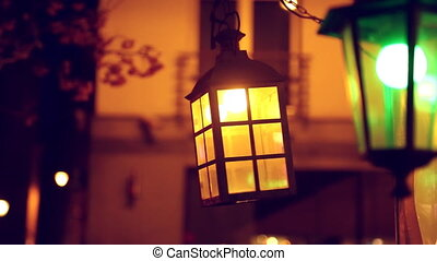 Swinging retro lamp at night. - Swinging retro victorian...