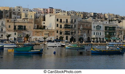 The panning of traditional Maltese boats in sunset, Kalkara,...