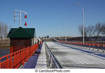 KOLOMNA, RUSSA - April, 2014: Movable floating bridge...