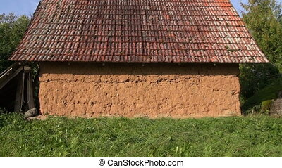 Old rustic clay barn in farm - Old rustic barn with clay...