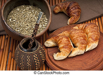 Yerba Mate tradition - Calabash cup for mate and croissants,...