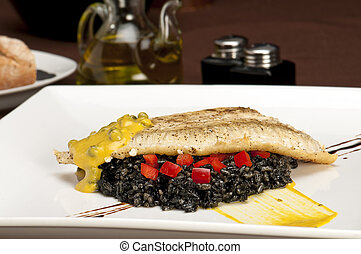 Halibut fillet delight - Plate of halibut fillet over a bed...