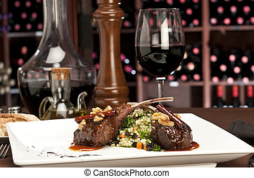 Lamb Chop plate - Close up of lamb chops with couscous and...