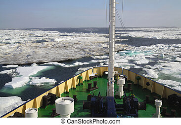 Research vessel in icy arctic sea