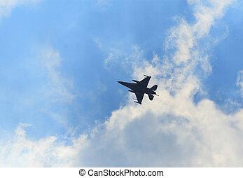 Jet-fighter maneuvering - Silllhuette of jet-fighter...