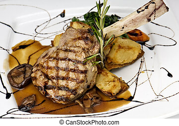 Broiled center cut veal chop with sauteed onions and...