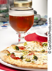Pizza and glass of beer - Plate of pizza with glass of beer...
