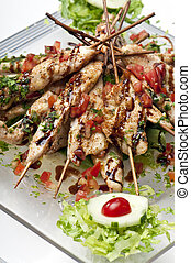 Plate of Grilled Chicken Teriyaki - Plate full ok kabobs of...