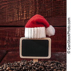 Christmas coffee beans and blank chalkboard on wooden table