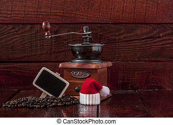 Christmas coffee grinder on wooden table