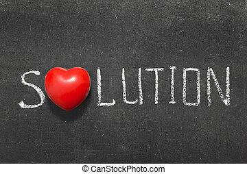 solution word handwritten on blackboard with heart symbol...