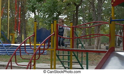 the little girl on the Playground riding a roller coaster -...