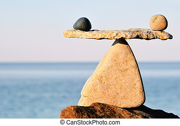 Black and white stones in balance at seashore