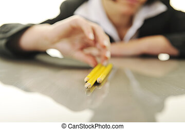 bosiness woman choosing perfect pencil - young business...