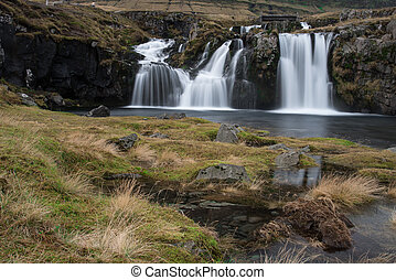 Beautiful waterfall landscape at Kirkjufell mountain,...