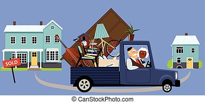 Downsizing seniors - Senior couple moving their belongings...