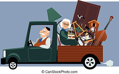 moving seniors - Senior couple in a pick-up truck moving...