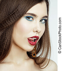 Sexy Beauty Girl with Red Lips and Nails. Provocative Make up. Luxury Woman with Blue Eyes. Fashion Brunette Portrait isolated on a white background. Gorgeous Woman Face. Long Hair