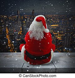 Suggestive Christmas city - Santa Claus looks the city while...