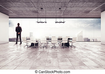 Successful businessman in a meeting room - Businessman looks...