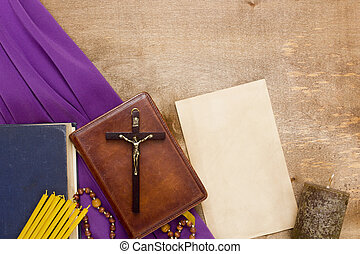Catholic wooden crucifix on the prayer book bound in leather...