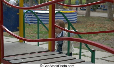 the little girl on the Playground riding a roller...