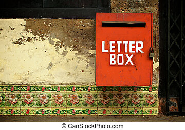 Red letterbox on tiled wall - Vintage style red letterbox on...