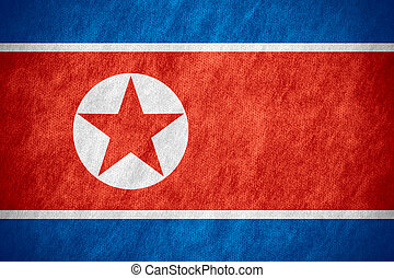 flag of North Korea or North Korean banner on canvas texture