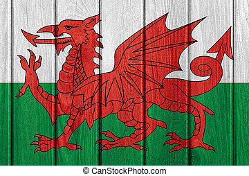 flag of Wales or Welsh banner on wood board texture