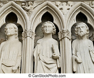 Statue. Entrance of the XIII century church. France. -...