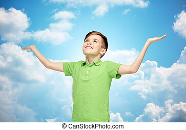 happy boy in polo t-shirt raising hands up - childhood,...