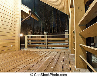 Wooden country house tarrace at night