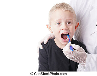 Boy gets help by the Dentist to brush his teeth