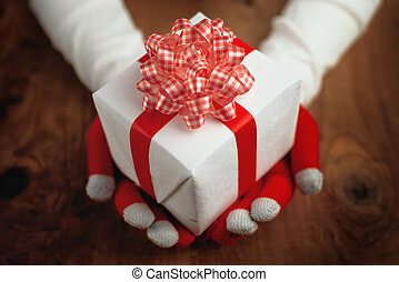Christmas gift for you, hands offering holiday present...