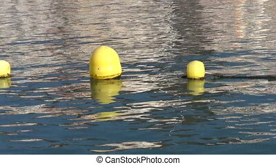 Buoys in the beach in Tenerife - Yellow buoys stringed on...