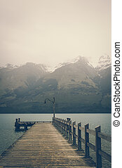 A Lonely Wooden Pier at Glenorchy on Lake Wakatipu with...