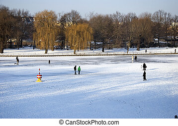 berlin winter - many people on the frozen berlin...