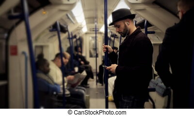 Man listening music on a tube train