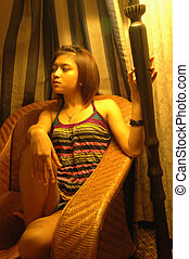 young lady sit down on sofa - young asian lady sit down on...