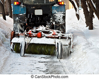 Tractor clears snow