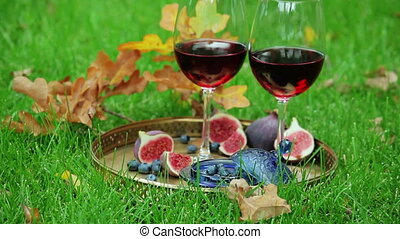 still life with red wine and berry