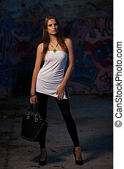 Urban style woman in an abandoned building