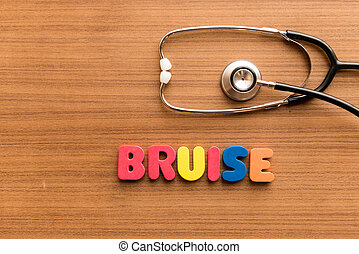 Bruise colorful word on the wooden background with...