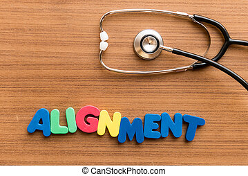 Alignment colorful word on the wooden background with...