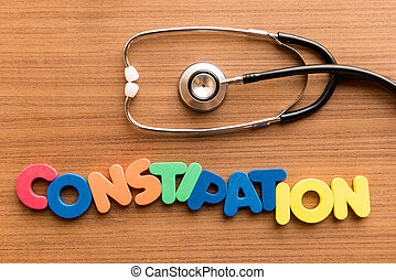 constipation colorful word on the wooden background with...