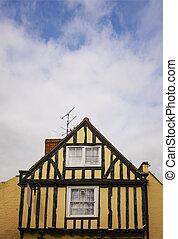 Yellow half timbered house