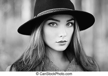 Portrait of young beautiful woman in autumn coat. Girl in...