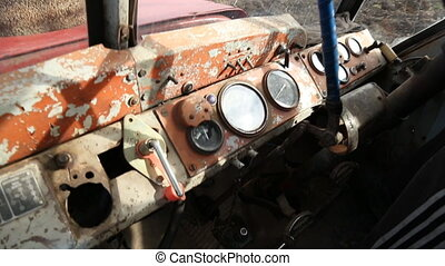 in the tractor cab - in the cockpit of an old tractor
