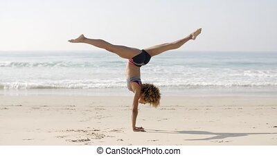 Woman Practicing Yoga Outdoors - Woman practicing yoga...