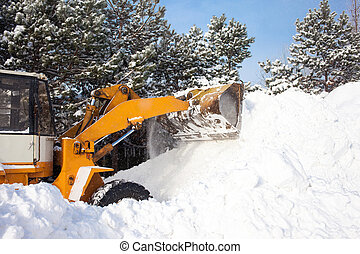 Wheel loader is cleaning a road from snow